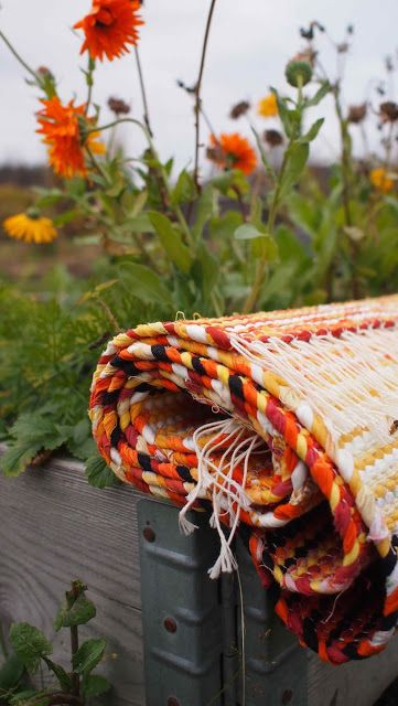 Liljan Lumo: Marigold -rag rug knitted by Liljan lumo using recycled material.