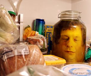 Hungry? Scare those fridge-bound famished food foragers with a head in a jar!  Using a photo editor, two pictures are blended together to create fl...