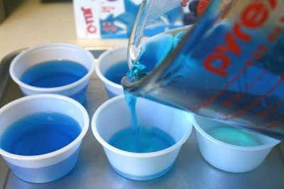 The Best Blue Jell-O Shot 1 package of blue jello 1 cup of boiling water 1 cup of coconut rum