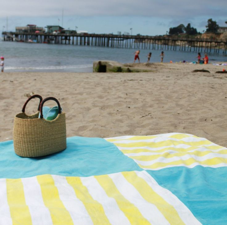 Sew old beach towels together to make one huge beach blanket. Great idea!