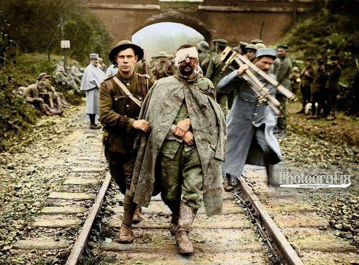 Battle of Ancre. A Military Policeman with a wounded German prisoner captured by the 39th Division at St. Pierre-Divion, France,  on November 13th 1916.  (Photo source - © IWM Q 4499) Photographer - Brooke, John Warwick (Lieutenant)  (Colourised by Tom Marshall from the UK) © PhotograFix  https://www.facebook.com/PhotograFixUK/