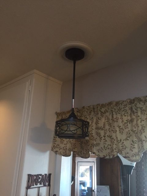 Here is the completed pendant light that replaced the recessed lighting that was there before and now there is much better lighting as well as a nice looking light.