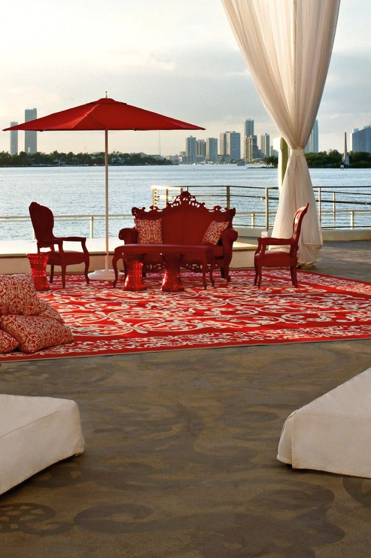 The Design Fantasy Continues In Pool Area Via Whimsical Oversize Furnishings And Red Canopies