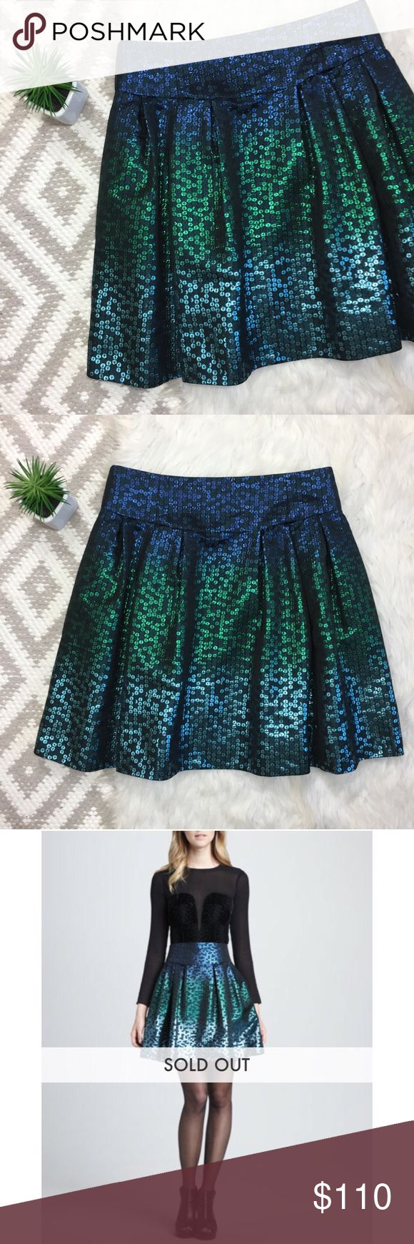 Nanette Lepore Escapade Iridescent A-Line Skirt Nannette Lepore Pleated A-Line Skirt   Pleated front. Keeps its structure. Pockets! Sequin pattern. Not actual sequins. All over black with Ombré blue & green mermaid vibe. Zipper back closure with buttons. No flaws, like NEW!  Size 8. Retail : $178 Length: 19 in Waist: 15 in flat Nanette Lepore Skirts A-Line or Full