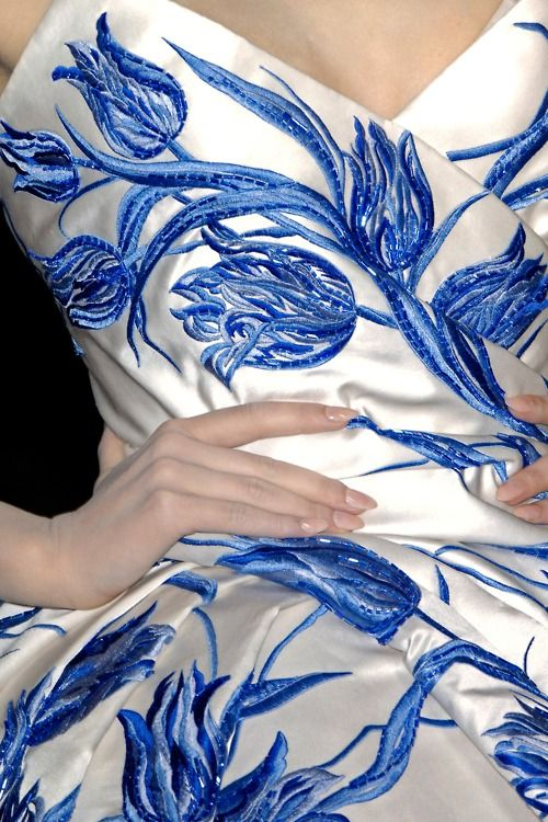 Chiristian Dior SS 2009 Haute Couture  ~~~  definitely embroidered to resemble Delftware, lovely blue tulips