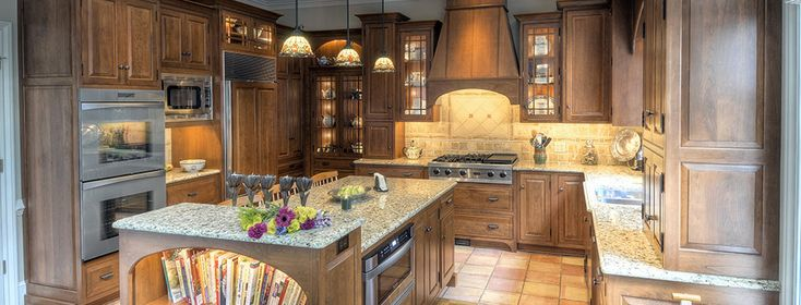 Located in Hershey, Pennsylvania, this Arts and Crafts style kitchen is constructed from solid Pennsylvania Cherry Wood, stained and glazed to increase it's warmth and beauty. In the left corner of this spacious kitchen is a Hideaway cabinet, which has been a growing trend for our clients. ← → x × Previous Next