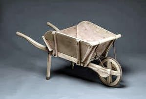 A child's wheelbarrow, early 20th Century wooden with metal supports and wheel rim 98cm (38½in) long