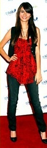 #VictoriaJustice : Red shirt with Black Vest. If you want a casual look, try this one out! Shop #DMLooks at DivaMall.tv