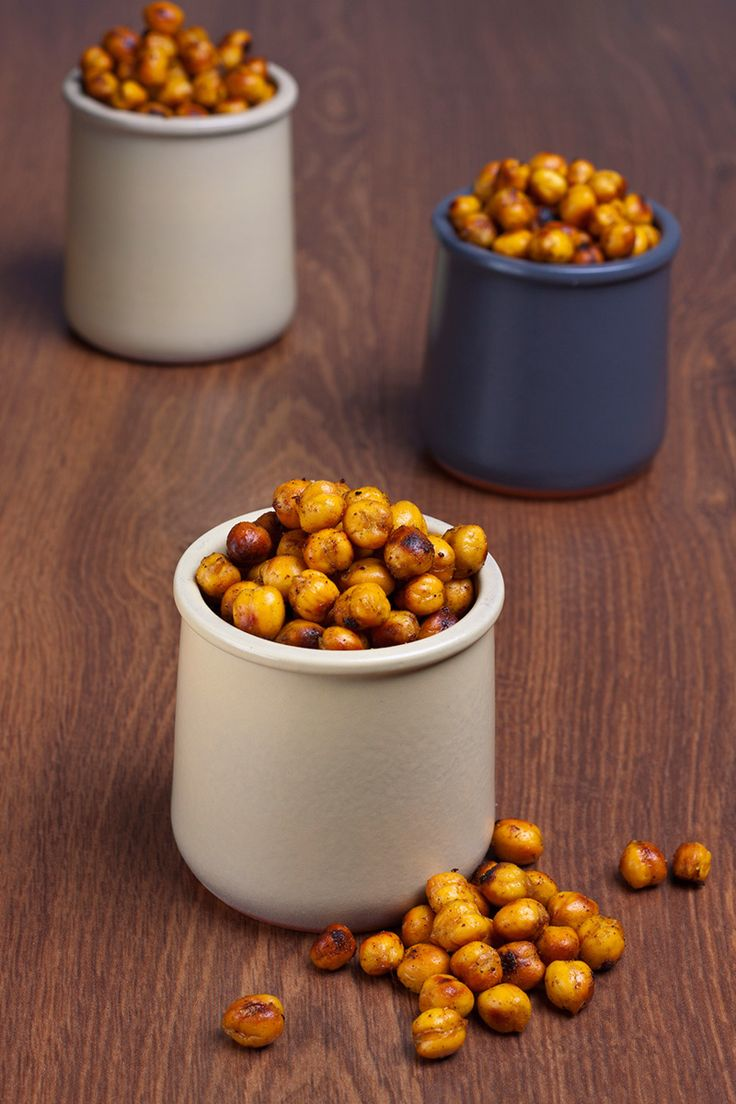 Smoky Paprika-Baked Garbanzo Beans Recipe—These jazzy little beans are hard to stop popping in your mouth and they are so easy to make it's almost ludicrous to call this a recipe. I often have some around to snack on. Big taste, little damage! — Art Smith