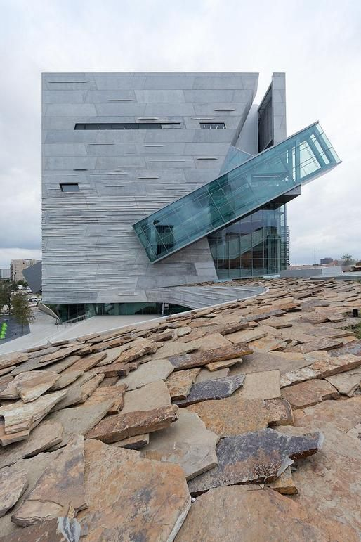 "Morphosis-designed Perot Museum of Nature and Science ""....An acre of undulating roofscape comprised of rock and native drought-resistant grasses reflects Dallas's indigenous geology and demonstrates a living system that will evolve naturally over time."""