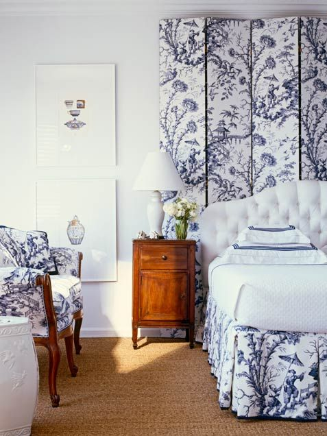 Bedroom Decorating Ideas: Posh Patterns       Navy and white chinoiserie fabric used throughout a bedroom feels sophisticated and fresh when mixed with a sisal carpet, crisp white bedding and white walls