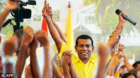 Ousted Maldivian President Mohamed Nasheed (pictured) is carried by his supporters during a meeting in Male