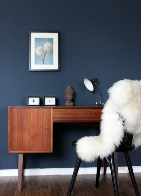 A super soft throw balances the masculine woods and navy wall paint colour.