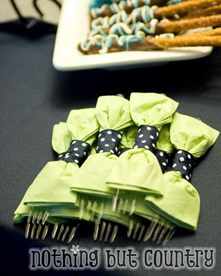 Little bow ties around the cutlery. Other ideas here also for a boy / mustache / bow tie theme.