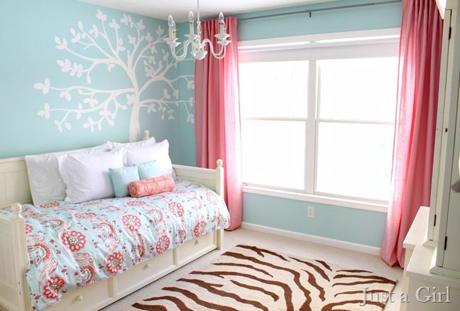 The tree painting on the wall is really unique and neat! Could be fun for a baby room. Also love the color pallet for this room.