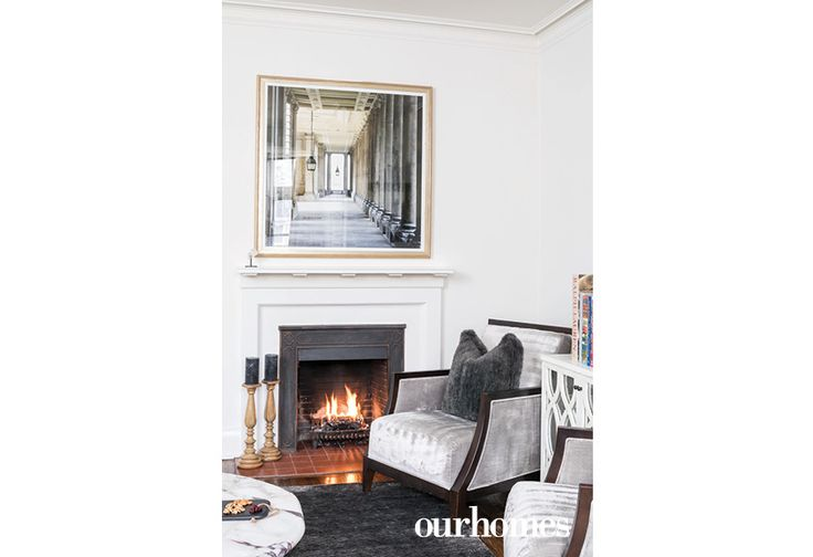 The red brick interior of the fireplace adds old-world charm.  http://www.ourhomes.ca/articles/build/article/confident-decisions-and-practical-interior-design?full=true#sthash.GzSEcoT7.dpuf