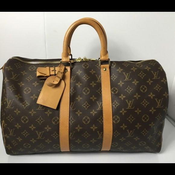 Exclusive authentication service & customer support. Free 1-3 day shipping for a limited time. Description: 100% Authentic Louis Vuitton Monogram Keepall 45 with Luggage Tag, Extender Lock and Key. Pre-Owned Bag in very good used condition. No rip , no crack, no tears on the canvas. Very clean inside. No bad odor. Leather, Handle and Bottom area has stains, marks and sign of wear. MADE IN FRANCE - DATE CODE SP1903 ( October 1993 ) Please check all the pictures. -In order to avoid unneces...
