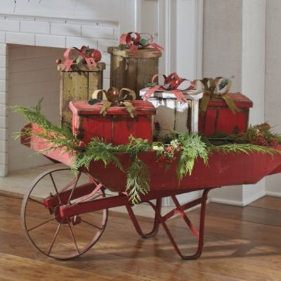 How cute..use an old wheel barrow, some greenery and wrapped empty boxes..perfect on the porch...