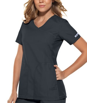 "About This Product  A Mock-wrap, coverstitched top features soft knit side panels, princess seams and inset front pockets. A twill tape tab with snap closure is at bottom left front complete this top. Center back length: 27""  Fabric: Brushed 65 Poly / 35 Cotton Poplin with Soil Release $16.99 #scrubs #nurses #nationalnursesweek #sale #cherokee"