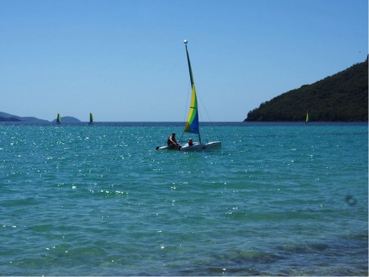 The catamarans are easy to sail and great fun, and each adult can sail with two young kids on board. #HamiltonIsland #Whitsundays