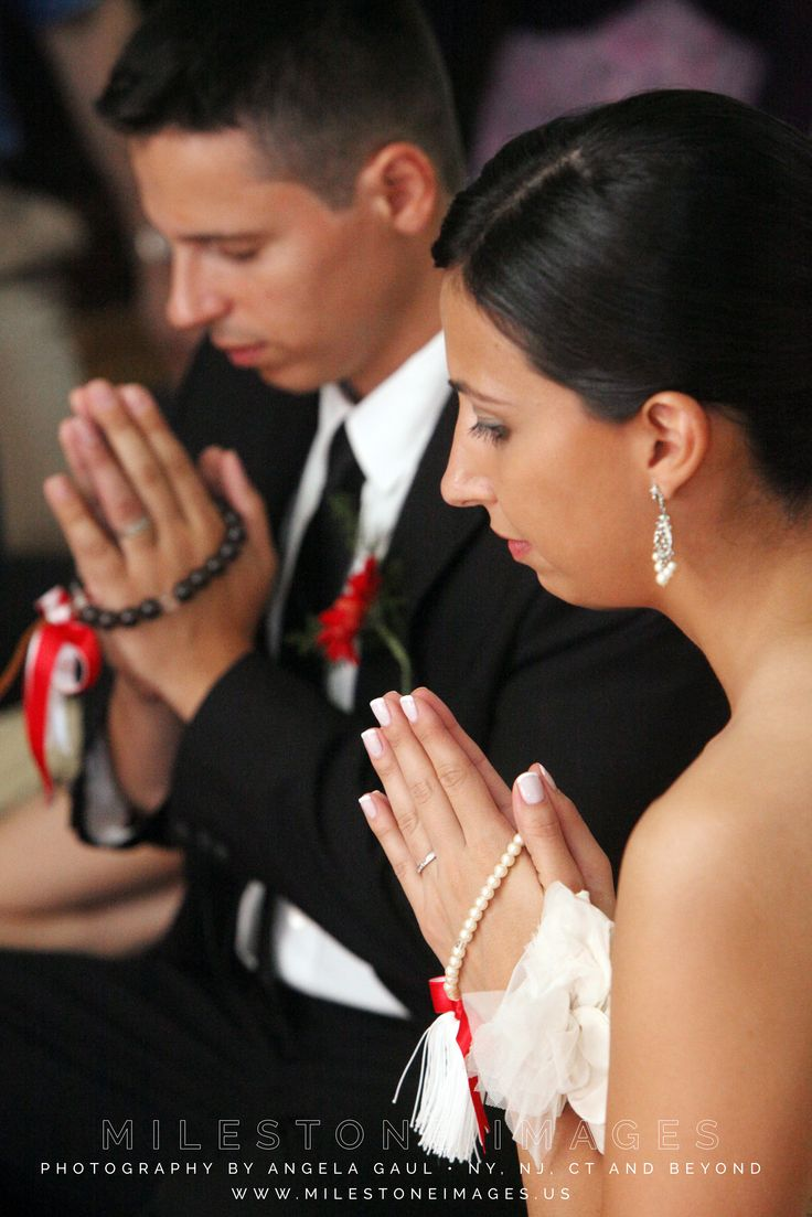 Buddhist wedding ceremonies involve a unity ritual where the bride and groom meditate together while prayer beads are draped over their hands.
