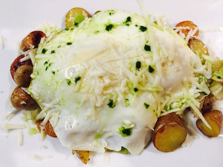 fingerling potato & leek hash, fried egg, shaved pecorino romano cheese, chive oil