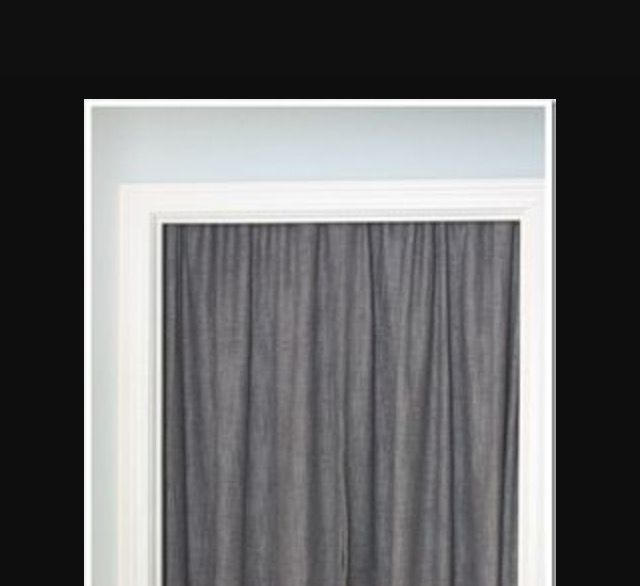 Cover Unused Door With Tension Rod And Curtain To Soften A