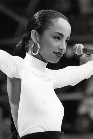 """Sade. After quickly releasing another album, Promise, which includes what is probably her best known hit, """"The Sweetest Taboo,"""" Sade toured the world for eight months. In 1985, she played Live Aid, gracing the stage as the only female artist at London's Wembley Stadium."""