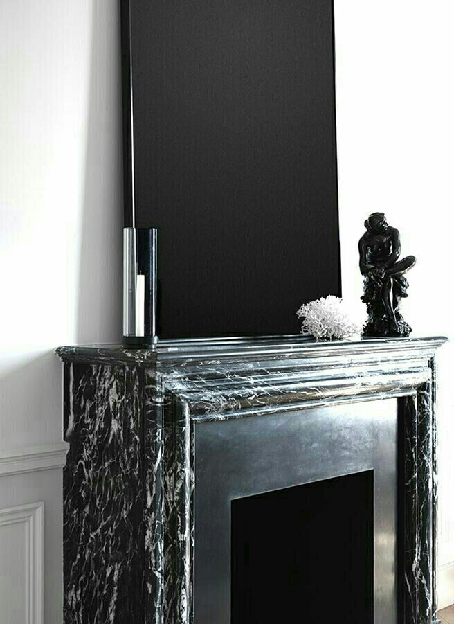 GUILLAUME ALAN - Black marble fireplace.