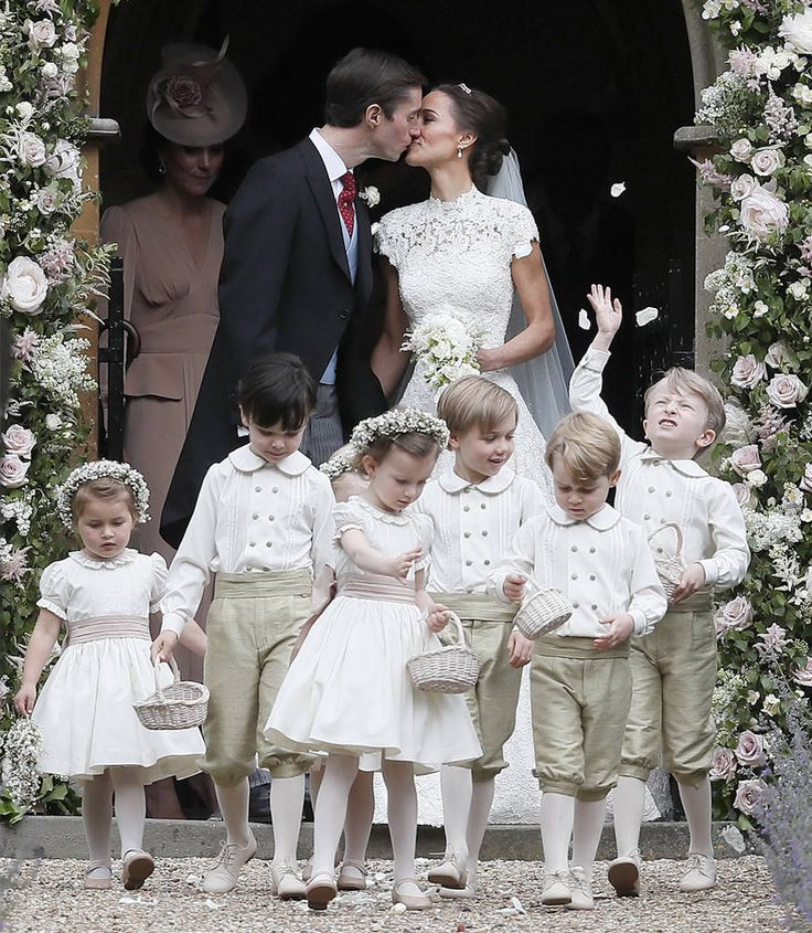 Pippa Middleton & James Matthews  Just married!  The lovebirds leave the church and stop for a kiss.