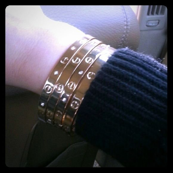 3x Love Bangle Kylie Jenner in gold THESE ARE NOT CARTIER.  Similar look to Kylie Jenners and other celebrities.  Made with Titanium - they snap on- one size fits all. Jewelry Bracelets