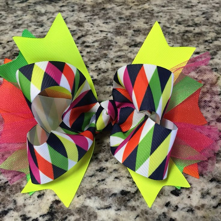 A personal favorite from my Etsy shop https://www.etsy.com/listing/255158643/neon-hair-bow-tulle-hair-bow-boutique