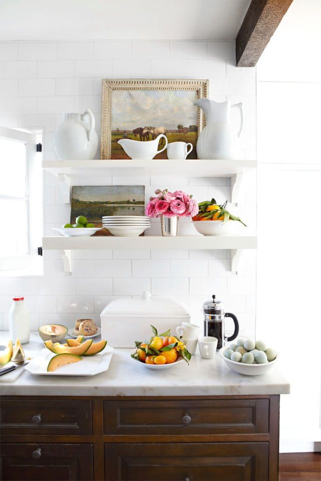 Thinking of trying open shelving? A hallmark of country kitchens, this everything-in-plain-sight strategy helps a space feel more collected and, in turn, more cozy.