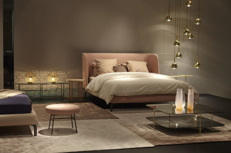 Glorious new Desdemone bed by Nasralleh & Horner for Ligne Roset. This cosseting piece will be available with a choice of back heights when it comes in-store Autumn 2016 . Shown with glam Brass Bell lights in translucent brass finish . Clyde low table in the foreground in brass with smoked glass and either marble to grey stoneware base. We hope this piece will be in store soon