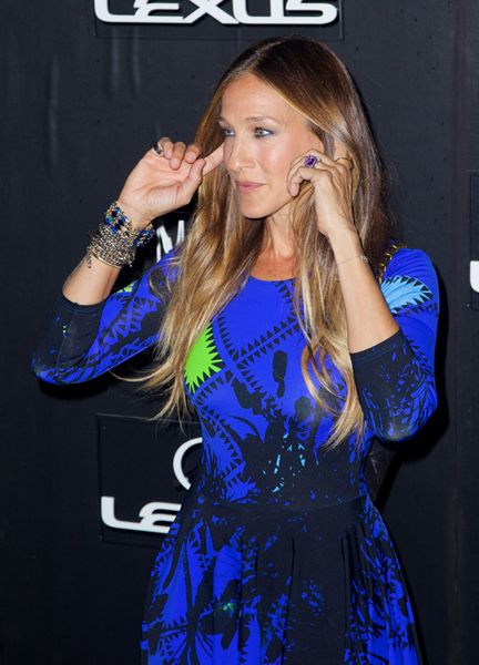 Sarah Jessica Parker...We Finally Figured Out Her Secret Weapon To Take Attention Away From Her Dress...