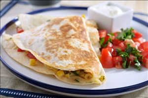 Edam-Up Quesadillas: Double decker buses are for London, but triple decker quesadillas are for your table! Layered with grated King's Choice® Edam and dollops of drained salsa. Cooked and browned in a skillet until crisp!
