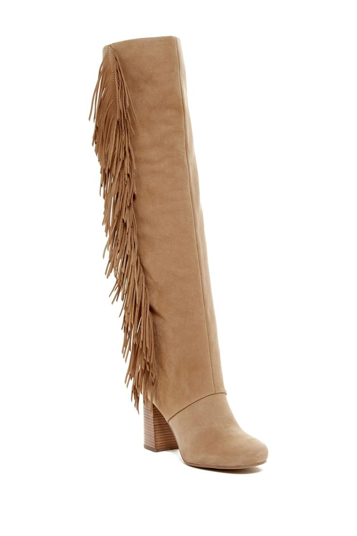 A stacked heel and dramatic fringe trim heighten the rustic, Western vibe of a look-defining over-the-knee boot.