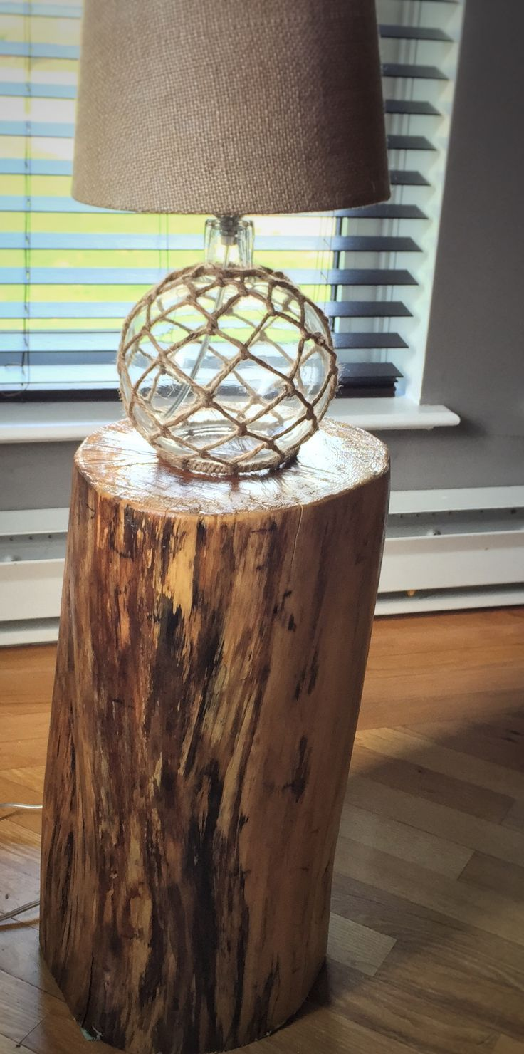 I've always been a big fan of raw wood and these accent tables give your space a bit of rustic elegance.  The key is finding the right log. 1. Make sure it's dry enough that the bark comes of fairly easily. 2. Let it soak up the sun after the bark has been removed. 3. Invest in an electric hand sander and go to town on the log. 4. Once sanded use wood sealer in clear to seal up all the exposed wood 5. Give it two or three coats of sealer depending on how much the log soaks it up