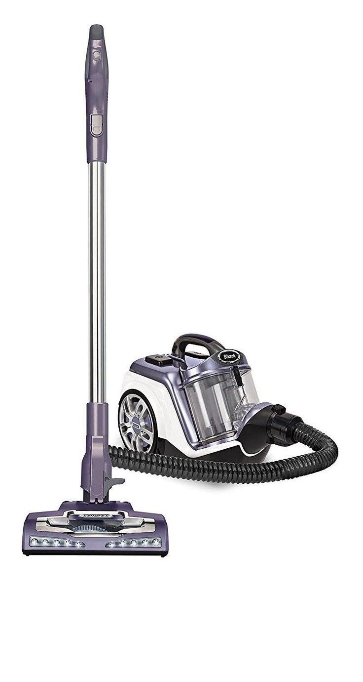 Rotator powered lift away canister vacuum