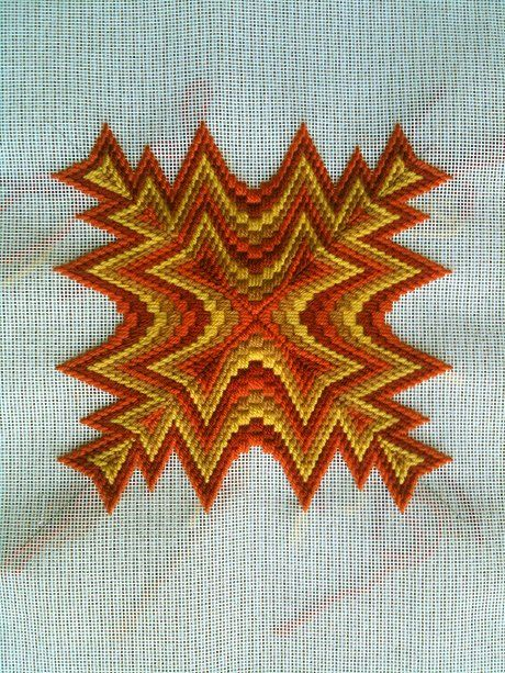 There is nothing let me repeat nothing like vintage bargello for pillows for mid mod houses. Troy is making his own, from scratch. Oh, and go orange!