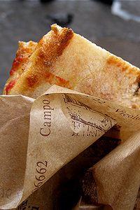 Pizza al taglio at Forno Campo de' Fiori, Rome. More on this awesome piazza at http://www.venice-italy-veneto.com/walking-tours-in-rome.html