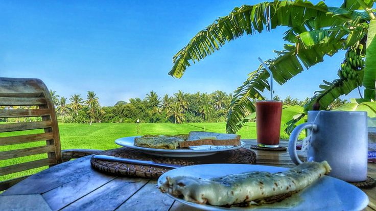 Breakfast and an amazing view at Bali Harmony villas!