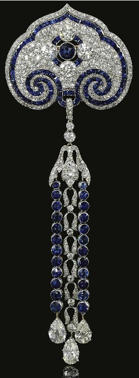 SAPPHIRE AND DIAMOND BROOCH/PENDANT, CIRCA 1910 The surmount pierced and millegrain-set with French-cut sapphires, circular-, single-cut and rose diamonds, collet-set at the centre with a circular-cut sapphire and similarly cut diamonds, suspending an articulated pendant composed of foliate motifs and lines of circular-cut sapphires, terminating on three pear-shaped diamonds, French assay marks.