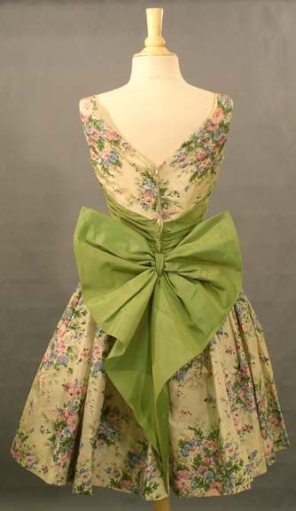 Vintage 1950s floral taffeta dress with gathered iridescent olive taffeta waist, and large bow detail in the back