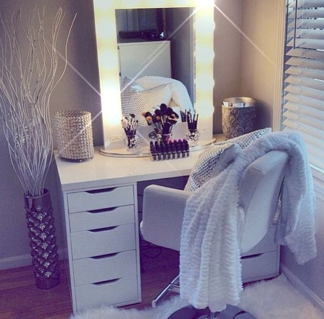 White vanity/dressing table from IKEA with Hollywood light mirror.
