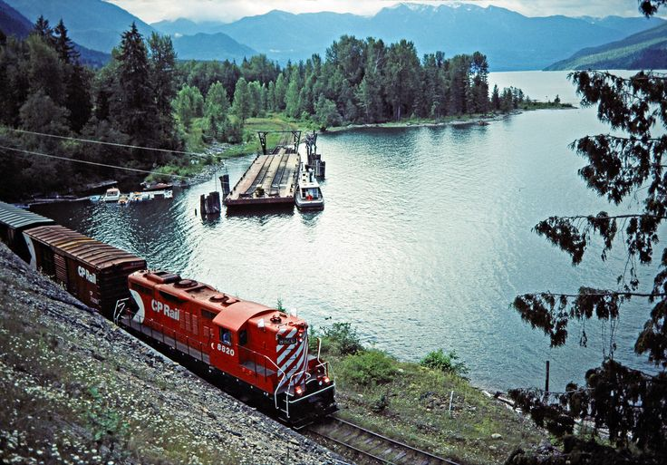 Northbound Canadian Pacific Railway local freight train led by GP9 no. 8820 at Slocan Lake in Rosebery, British Columbia, on July 14, 1983. The train has just completed a trip across the lake on the barge in the background. Photograph by Rarely-seen angle! John F. Bjorklund, © 2015, Center for Railroad Photography and Art. Bjorklund-38-08-09