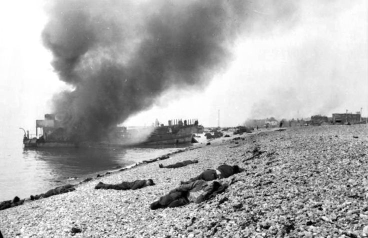 Destroyed landing craft on fire with Canadian dead on the beach. A concrete gun emplacement on the right covers the whole beach. The steep grad can clearly be judged.