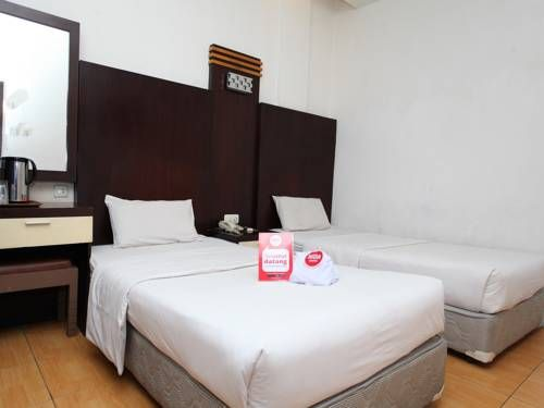 NIDA Rooms Pekan Raya Carrefour Medan Medan NIDA Rooms Pekan Raya Carrefour Medan offers accommodation in Medan. It features an outdoor pool, a restaurant and a lounge room.  Air-conditioned rooms come with a private bathroom equipped with a bath or shower. Linen and towels are provided.