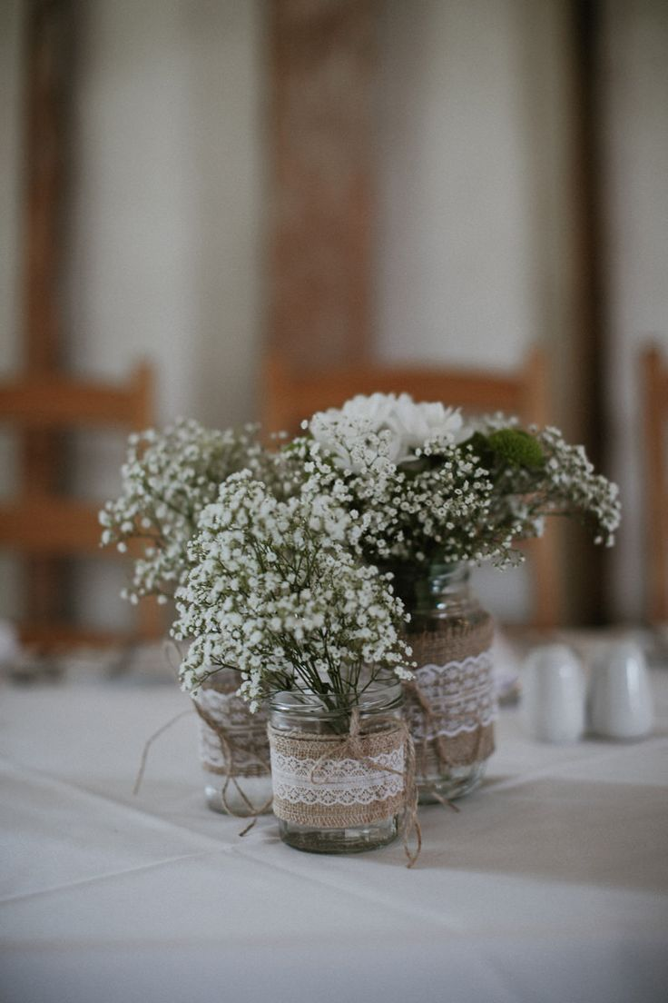Jam Jars wrapped in Hessian & Lace & filled with Gypsophila - James Frost Photography | Southend Barns | Wedding With Vintage Travel Theme