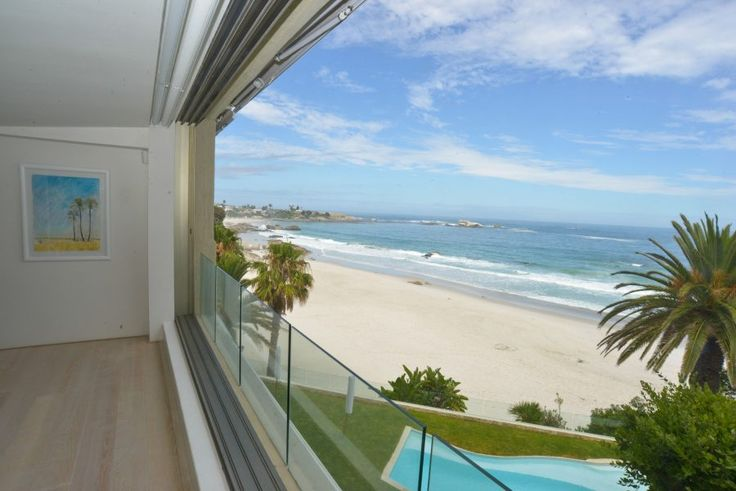 🌟 AVAILABLE SUMMER 2017 AND DEC/JAN.  Experience Heron Waters A luxurious 3 bedroom holiday apartment in a Clifton apartment block facing the sea. The apartment has direct access to the beach and a communal pool and BBQ area. The apartment is perfect for entertaining with a spacious and open plan living area with stunning views.  Featuring 3 bedrooms (one en-suite) sleeping 6, guest bathroom with shower.